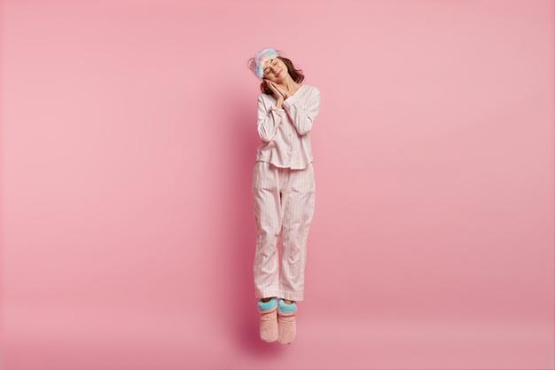 woman-wearing-sleep-mask-pajamas_273609-21350